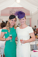 Laurent Perrier Champagne is proud to be celebrating its 4th year sponsoring the luxurious Champagne Tent at the Galway Races.  The  place to be at the festival, the tent has become synonymous with beauty, style and  elegance with guests enjoying the lovely surroundings while enjoying a glass of champagne and taking in all the festivities on offer at theRaces.<br /> <br /> Pictured at the Laurent-Perrier Champagne Tent (from left to right) is: Chanelle McCoy and Gillian Walsh (Jockey wives) Photo:-Andrew Downes/ XPOSURE.IE .