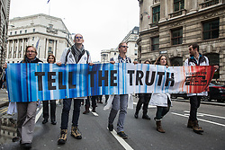 London, UK. 14 October, 2019. Climate activists from Scientists for Extinction Rebellion march close to London Bridge in the City on the eighth day of International Rebellion protests across London. Today's activities were concentrated around the City of London's finance district.