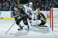 KELOWNA, CANADA - JANUARY 26: Carter Rigby #11 of the Kelowna Rockets looks for the puck as Sawyer Lange #5 Prince Albert Raiders skates with the puck at the Kelowna Rockets on January 26, 2013 at Prospera Place in Kelowna, British Columbia, Canada (Photo by Marissa Baecker/Shoot the Breeze) *** Local Caption ***