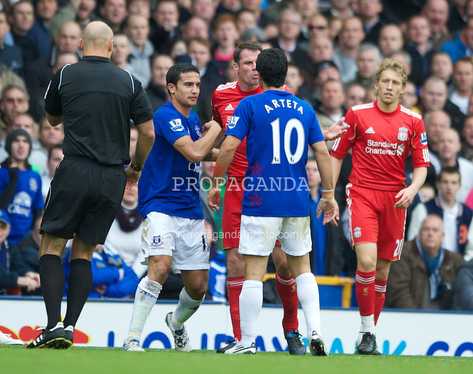 LIVERPOOL, ENGLAND - Sunday, October 17, 2010: Liverpool's Jamie Carragher clashes with Everton's Mikel Arteta and Tim Cahill tries to diffuse the situation during the 214th Merseyside Derby match at Goodison Park. (Photo by Chris Brunskill/Propaganda)