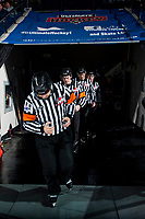 KELOWNA, CANADA - MARCH 31: Referees Chris Crich and Reid Anderson, followed by linesmen Dustin Minty and Kevin Crowell enter the ice at the Kelowna Rockets against the Kamloops Blazers on March 31, 2017 at Prospera Place in Kelowna, British Columbia, Canada.  (Photo by Marissa Baecker/Shoot the Breeze)  *** Local Caption ***