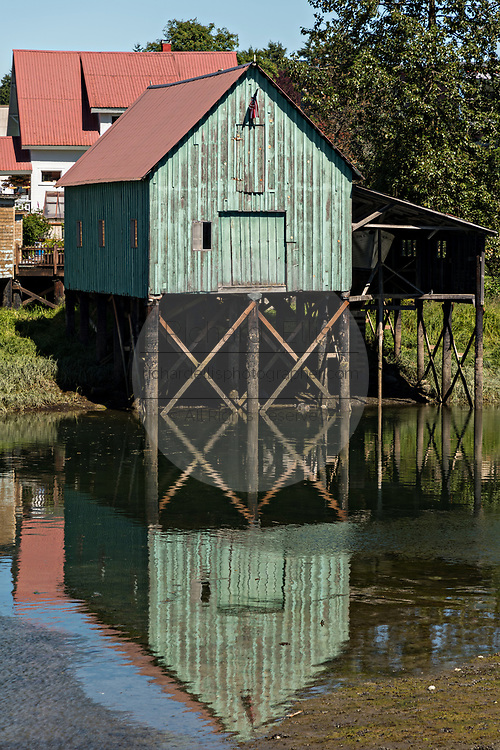 An old wooden stilt boat house on Hammer Slough in Petersburg, Mitkof Island, Alaska. Petersburg settled by Norwegian immigrant Peter Buschmann is known as Little Norway due to the high percentage of people of Scandinavian origin.
