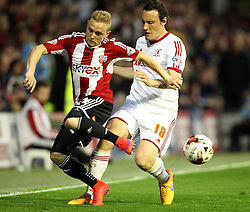Brentford's Alex Pritchard flicks the ball past Middlesbrough's Dean Whitehead - Photo mandatory by-line: Robbie Stephenson/JMP - Mobile: 07966 386802 - 08/05/2015 - SPORT - Football - Brentford - Griffin Park - Brentford v Middlesbrough - Sky Bet Championship