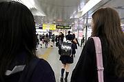 elementary school child walking train station Japan