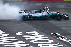 Oct 29, 2017 - Mexico City, Mexico - British driver LEWIS HAMILTON of Mercedes AMG does a burn out to celebrate winning his 4th F1 Driver's Championship after the finish of the Formula One Mexico Grand Prix, held at the Hermanos Rodriguez racetrack. Hamilton's 9th place finish gave him enough points to clinch the championship with two races left to run in the season. (Credit Image: © Hoch Zwei via ZUMA Wire)