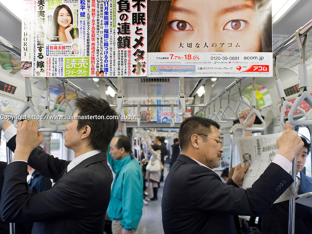 Advertising poster inside subway train on Tokyo metro in Japan