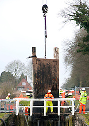 © under license to London News Pictures.  Workers hang a new gate at Caen Hill Locks on the Kennet and Avon Canal on February 8, 2011. The 29 locks have a rise of 237 feet in 2 miles (72 m in 3.2 km) or a 1 in 44 gradient.Photo credit should read david Mirzoeff/ London News Pictures
