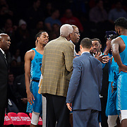 January 9, 2018, New York, NY : Georgetown coach Patrick Ewing, in glasses at center, is pictured with his team during Tuesday night's matchup between the Hoyas and Red Storm at Madison Square Garden. In something of a rematch of their 1985 contest, Basketball greats Patrick Ewing and Chris Mullin returned to Madison Square Garden on Tuesday night to face off as coaches with their respective Georgetown and St. John's teams.  CREDIT: Karsten Moran for The New York Times
