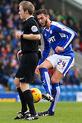 Chesterfield FC midfielder Ollie Banks pass his referee Gavin Ward during the Sky Bet League 1 match between Chesterfield and Crewe Alexandra at the Proact stadium, Chesterfield, England on 20 February 2016. Photo by Aaron Lupton.