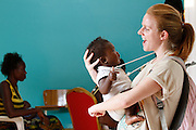 South African student Sophie Winton holds baby Winner Kalamba on the second day of screening...Operation Smile South Africa.Clinique Ngaliema, Avenue Des Cliniques.KInshasa, DRC Mission, June 3rd-12th 2011..© Zute & Demelza Lightfoot.www.lightfootphoto.com...
