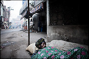 """A man, homeless, sleep on the ground. Lahore, Pakistan, on monday, December 01 2008.....""""Pakistan is one of the countries hardest hits by the narcotics abuse into the world, during the last years it is facing a dramatic crisis as it regards the heroin consumption. The Unodc (United Nations Office on Drugs and Crime) has reported a conspicuous decline in heroin production in Southeast Asia, while damage to a big expansion in Southwest Asia. Pakistan falls under the Golden Crescent, which is one of the two major illicit opium producing centres in Asia, situated in the mountain area at the borderline between Iran, Afghanistan and Pakistan itself. .During the last 20 years drug trafficking is flourishing in the Country. It is the key transit point for Afghan drugs, including heroin, opium, morphine, and hashish, bound for Western countries, the Arab states of the Persian Gulf and Africa..Hashish and heroin seem to be the preferred drugs prevalence among males in the age bracket of 15-45 years, women comprise only 3%. More then 5% of whole country's population (constituted by around 170 milion individuals),  are regular heroin users, this abuse is conspicuous as more of an urban phenomenon. The substance is usually smoked or the smoke is inhaled, while small number of injection cases have begun to emerge in some few areas..Statistics say, drug addicts have six years of education. Heroin has been identified as the drug predominantly responsible for creating unrest in the society."""""""