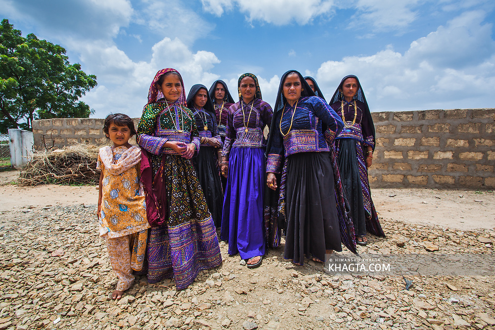 Group of village woman poses before going to attend the wedding of their friend.