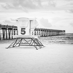 Pensacola Beach Gulf Pier and lifeguard tower five black and white photo. Pensacola Beach is on Santa Rosa Island in the Emerald Coast area of the Southeastern United States of America. Copyright ⓒ 2018 Paul Velgos with All Rights Reserved.