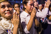 "04 FEBRUARY 2013 - PHNOM PENH, CAMBODIA:  Cambodians cry out and pray at the cremation of their former King Norodom Sihanouk during the King-Father's cremation service in Phnom Penh. Norodom Sihanouk (31 October 1922 - 15 October 2012) was the King of Cambodia from 1941 to 1955 and again from 1993 to 2004. He was the effective ruler of Cambodia from 1953 to 1970. After his second abdication in 2004, he was given the honorific of ""The King-Father of Cambodia."" Sihanouk died in Beijing, China, where he was receiving medical care, on Oct. 15, 2012.   PHOTO BY JACK KURTZ"