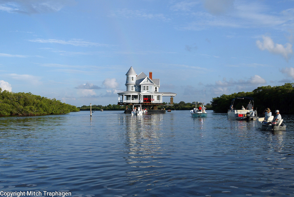 A century-old,  7,000 square foot Victorian mansion made a 25 mile voyage aboard a barge across Tampa Bay.  The house was moved on water to allow it to remain in one piece.  Contact photographer for complete information.