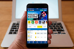 Using iPhone smartphone to display available sports at William Hill online betting app