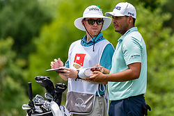May 4, 2019 - Charlotte, NC, U.S. - CHARLOTTE, NC - MAY 04: Sebastian Munoz talks over the pin placement on the 4th hole with his caddie during the third round of the Wells Fargo Championship at Quail Hollow on May 4, 2019 in Charlotte, NC. (Photo by William Howard/Icon Sportswire) (Credit Image: © William Howard/Icon SMI via ZUMA Press)