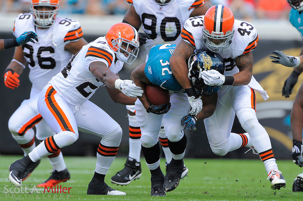 Jacksonville Jaguars running back Maurice Jones-Drew (32) is tackled by Cleveland Browns safety T.J. Ward (43) and cornerback Sheldon Brown (24) during the Jags 24-20 win at EverBank Field on November 21, 2010 in Jacksonville, Florida...©2010 Scott A. Miller