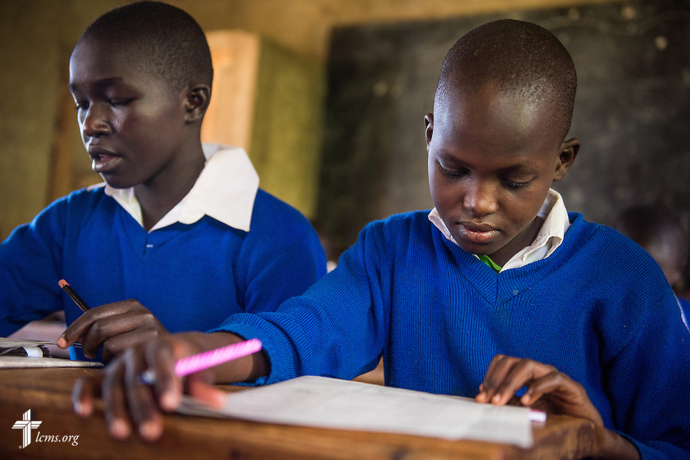 Several students from the U-Dom ELCK (Evangelical Lutheran Church in Kenya) Project 24 site prepare for exams on Thursday, June 23, 2016, at the Propoi Primary School in Chepareria, Kenya.  LCMS Communications/Erik M. Lunsford
