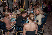 EVA SCHWARZ; VANESSA STIRLING; ELISABETH KAUFMAN; SEANA HULL EXAMINING MODEL WEARING AVAKIAN JEWELRY The Foreign Sisters lunch sponsored by Avakian in aid of Cancer Research UK. The Dorchester. 15 May 2012
