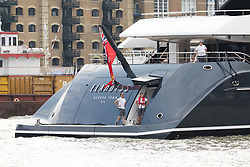 © Licensed to London News Pictures. 04/07/2018. London, UK.  The new 243 feet long superyacht, Elandess arrives in London for the first time ever on the River Thames shortly before mooring at HMS President, the Royal Navy Reserve Unit next to St Katharine Docks and Tower Bridge this evening. Elandess was built at the Abeking and Rasmussen shipyard in Germany, launched in May 2018 and has just completed sea trials ahead of its London visit. Elandess has an axe-bow, dark hull and low-slung superstructure. There are a variety of entertaining communal spaces, from the 8 x 2.5-metre superyacht swimming pool located on the massive sun deck to the Nemo Lounge with portholes below the waterline and an observation lounge on the upper deck. Guest accommodation includes six staterooms, including the master suite which is placed forward on the main deck with an observation lounge directly above on the upper deck.  Photo credit: Vickie Flores/LNP