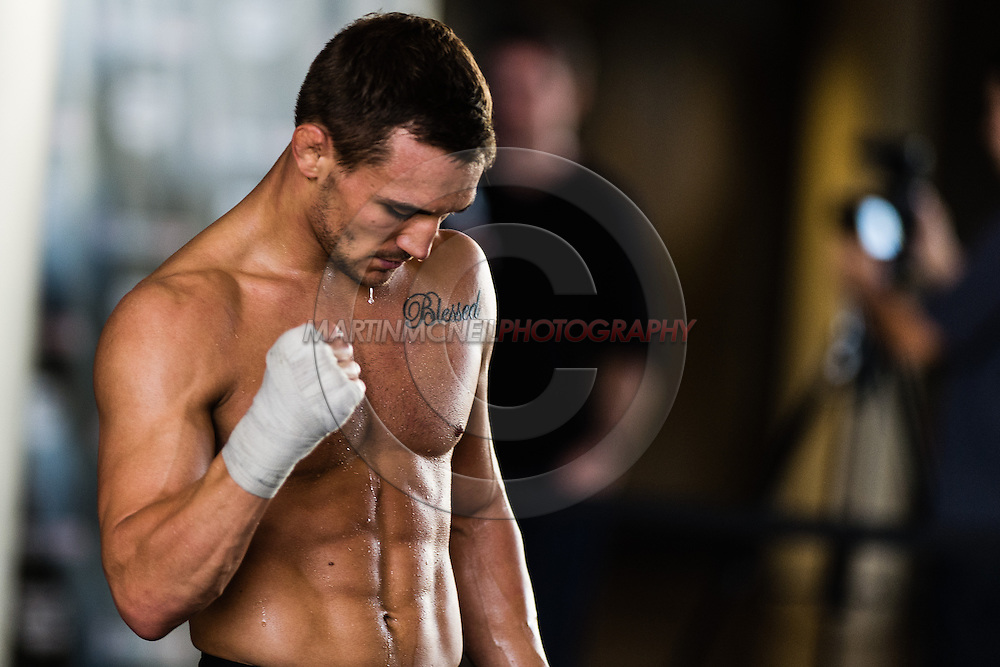 LONG BEACH, CALIFORNIA, OCTOBER 31, 2013: Michael Chandler works out on the mats ahead inside the Long Beach Convention Center & Arena, California, ahead of their fight at Bellator CVI (© Martin McNeil)