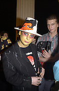 Boy George. Fergus Greer/ Leigh Bowery photographs. I.C.A. party. 18 July 2002. © Copyright Photograph by Dafydd Jones 66 Stockwell Park Rd. London SW9 0DA Tel 020 7733 0108 www.dafjones.com