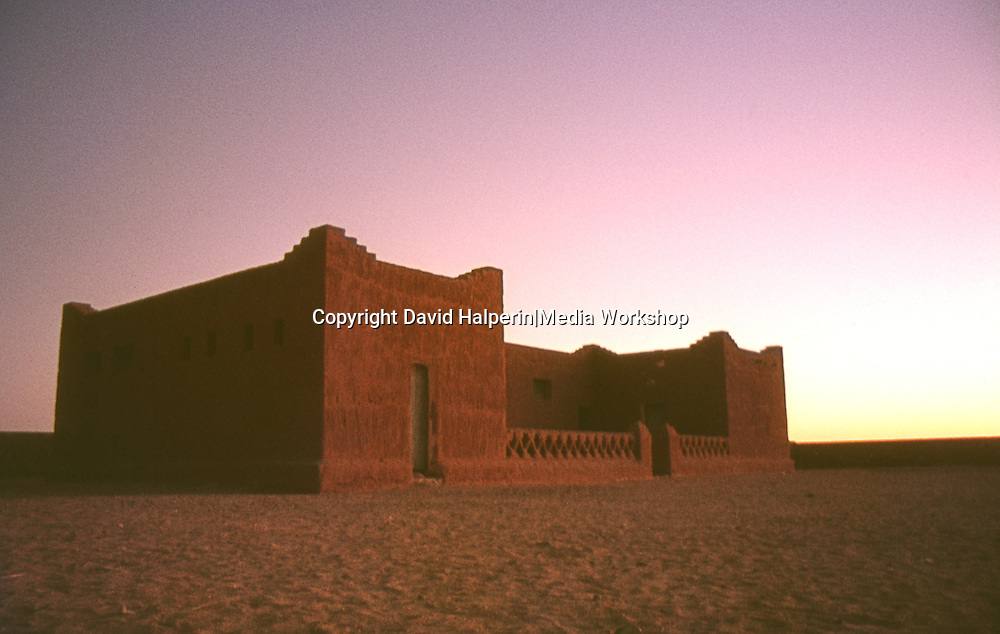 Adobe house at sunset in village of Amsel, middle of Sahara desert
