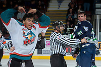 KELOWNA, CANADA -FEBRUARY 10: Tyrell Goulbourne #12 of the Kelowna Rockets yells to the fans after dropping the gloves in the final moments of the third period with Jared Hauf #33 of the Seattle Thunderbirds on February 10, 2014 at Prospera Place in Kelowna, British Columbia, Canada.   (Photo by Marissa Baecker/Getty Images)  *** Local Caption *** Tyrell Goulbourne; Jared Hauf;