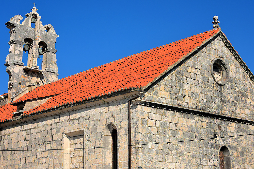Church of All Saints in Korčula, Croatia<br /> The Church of All Saints was built during the early 15th century above the Kula Svih Svetih city walls near the waterline.  Other churches from the 10th and 13th centuries previously occupied this location. The simple, three-bell campanile was added in 1749.  The Brotherhood of All Saints, called Sasvetani in Croatian, was founded in Korčula in 1301.