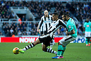 Newcastle United midfielder Isaac Hayden (#14) slides to make a pass during the EFL Sky Bet Championship match between Newcastle United and Derby County at St. James's Park, Newcastle, England on 4 February 2017. Photo by Craig Doyle.