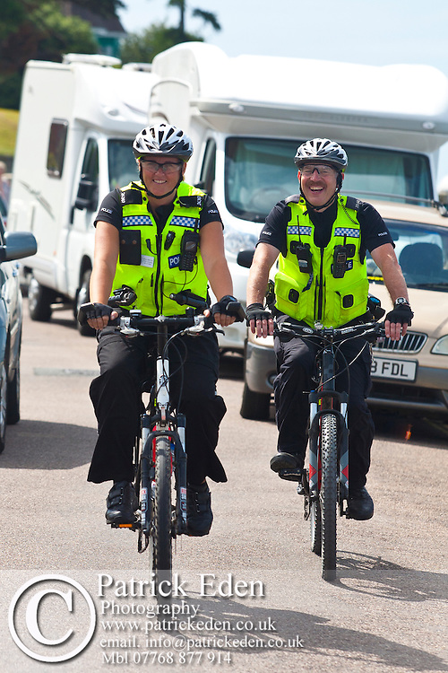 Police Officers, Street, Patrol, Cycling, Egypt Point, Cowes week, Cowes, Isle of Wight, England, UK, photography photograph canvas canvases