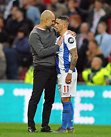 Football - 2018 / 2019 Emirates FA Cup - Semi-Final: Manchester City vs. Brighton & Hove Albion<br /> <br /> Man City Manager Pep Guardiola consoles 'Man of the matchh' Anthony Knockaert after the match, at Wembley Stadium.<br /> <br /> COLORSPORT/ANDREW COWIE