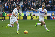 Leeds United midfielder Ezgjan Alioski (10) and Leeds United midfielder Adam Forshaw (4) during the EFL Sky Bet Championship match between Wigan Athletic and Leeds United at the DW Stadium, Wigan, England on 4 November 2018.
