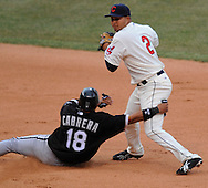 Orlando Cabrera is called for interference on Jhonny Peralta in the eighth inning Monday, March 31 at Progressive Field in Cleveland. The Indians defeated the White Sox 10-8.