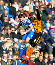 Brighton and Hove Albion's Dale Stephens challenges for the high ball with Wolverhampton Wanderers' Matt Doherty  - Photo mandatory by-line: Harry Trump/JMP - Mobile: 07966 386802 - 14/03/15 - SPORT - Football - Sky Bet Championship - Brighton v Wolves - Amex Stadium, Brighton, England.