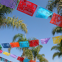 Mexico. Dia de Los Muertos, or Day of the Dead, flags and palm trees.