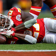 Kansas City Chiefs running back Kareem Hunt (27) pretended to take a nap using the football as a cushion after his second touchdown on the game in the 27-20 win over the Philadelphia Eagles on September 17, 2017 at Arrowhead Stadium in Kansas City, Mo.