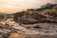 The sun rises over Swiftcurrent Creek in the Many Glacier area of Montana's Glacier National Park.