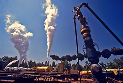 Stock photo of CO2 fracking in an East Texas oil field with the pipes attached to the Christmas Tree valves in the foreground