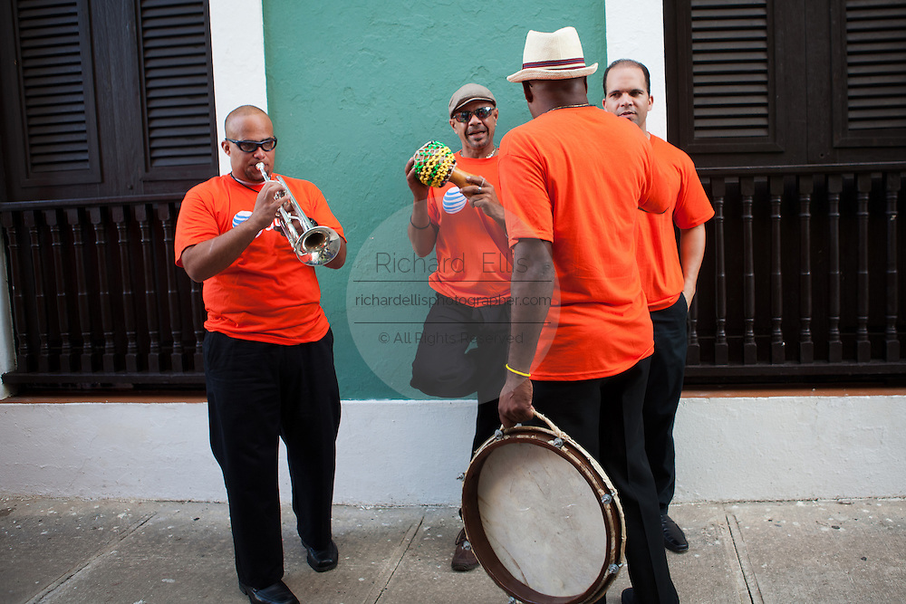 Band members relax before performing during the Festival of San Sebastian in San Juan, Puerto Rico.