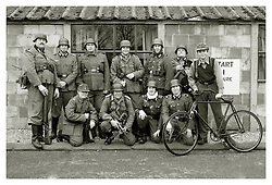 Reenactors portraying German panzer Grenadiers pose for a group photograph at Eden Camp Malton Nr Pickering<br />