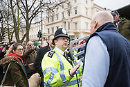 A policeman stops sheep being unloaded from a van as farmers gather in Waterloo Place, Westminster to march through London before delivering a petition to Downing Street calling for fairer producer prices.<br /> Picture by Paul Davey/Focus Images Ltd +447966 016296<br /> 23/03/2016
