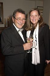 MR & MRS JOSEPH ETTEDGUI, he is designer Joseph, at a reception in London on 26th September 2000.OHI 20