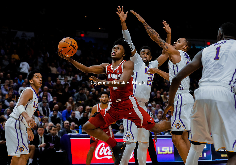 Jan 13, 2018; Baton Rouge, LA, USA; Alabama Crimson Tide guard Collin Sexton (2) shoots over LSU Tigers forward Aaron Epps (21) and guard Daryl Edwards (5) during the first half at the Pete Maravich Assembly Center. Mandatory Credit: Derick E. Hingle-USA TODAY Sports