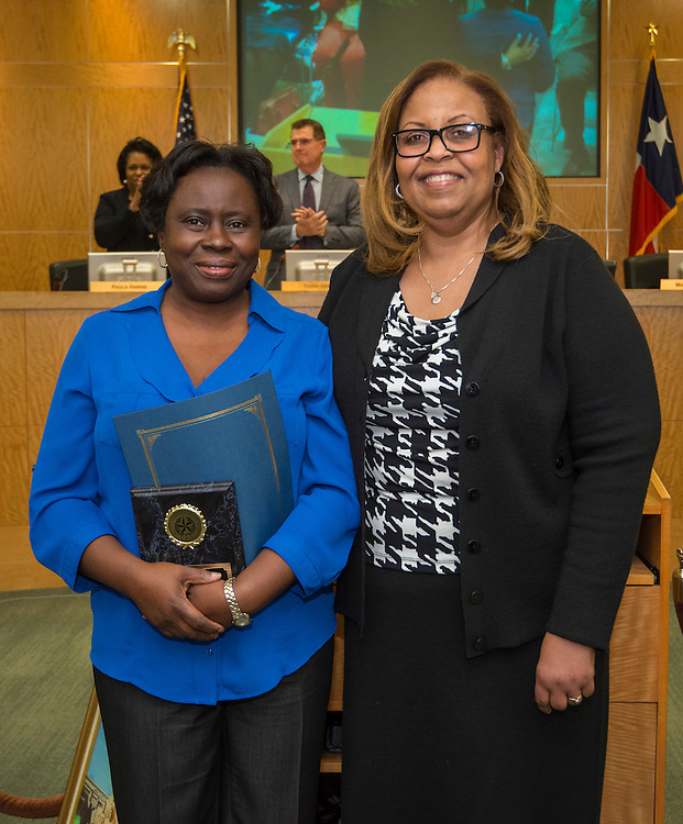Sheila Figgs, left, poses for a photograph with MLK Early Childhood Center principal Gabrielle Coleman, right, after being named Houston ISD Employee of the Month, February 12, 2015.