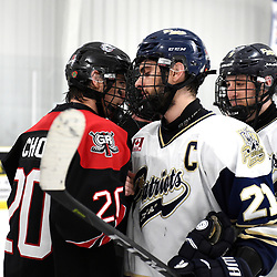 TORONTO, ON  - APR 10,  2018: Ontario Junior Hockey League, South West Conference Championship Series. Game seven of the best of seven series between Georgetown Raiders and the Toronto Patriots. Austin Cho #20 of the Georgetown Raiders and Andrew Petrucci #21 of the Toronto Patriots after the final buzzer of the South West Conference.<br /> (Photo by Andy Corneau / OJHL Images)