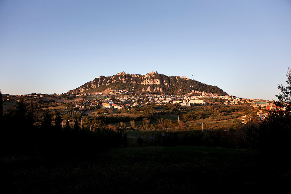 DOMAGNANO, SAN MARINO - 4 OCTOBER 2011: A view of Mount Titano and the capital San Marino with its Three Towers in Domagnano at dawn, in San Marino on October 4, 2011. The San Marino national football team is the last team in the FIFA  World Ranking (position 203). San Marino, whose population reaches 30,000 people, has never won a game since the team was founded in 1988. They have only ever won one game, beating Liechtenstein 1&ndash;0 in a friendly match on 28 April 2004. The Republic of San Marino, an enclave surronded by Italy situated on the eastern side of the Apennine Moutanins, is the oldest consitutional republic of the world<br /> <br /> <br /> ph. Gianni Cipriano