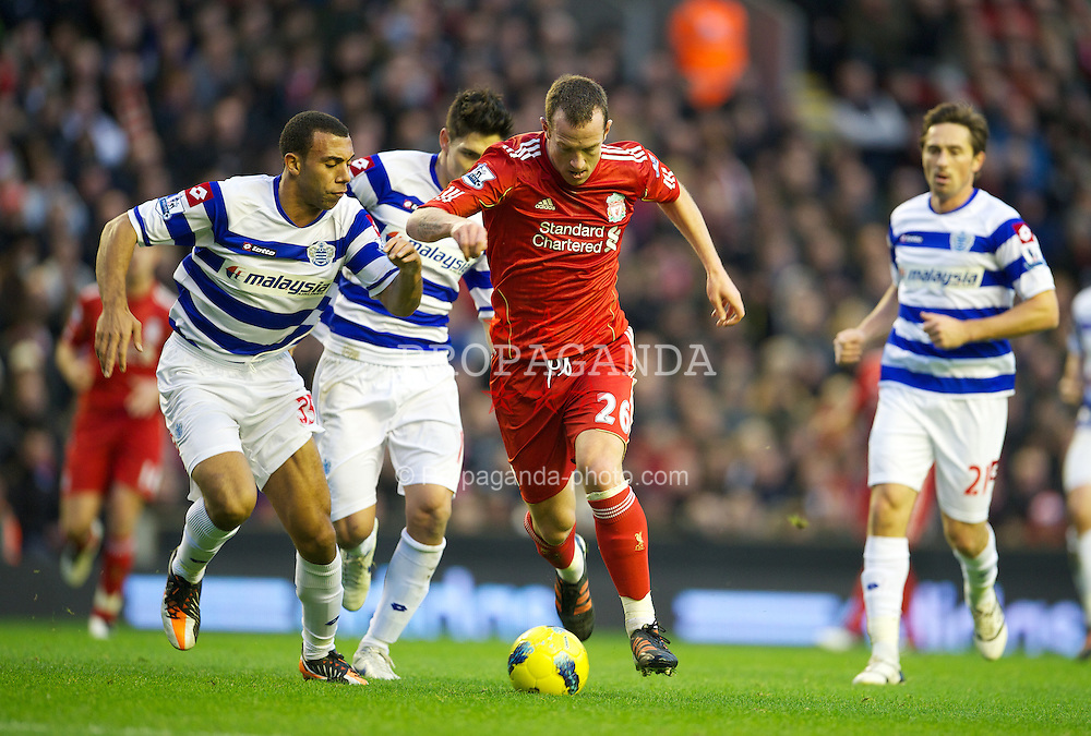 LIVERPOOL, ENGLAND - Saturday, December 10, 2011: Liverpool's Charlie Adam in action against Queens Park Rangers' Anton Ferdinand during the Premiership match at Anfield. (Pic by David Rawcliffe/Propaganda)