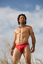 sexy man in a speedo outdoors